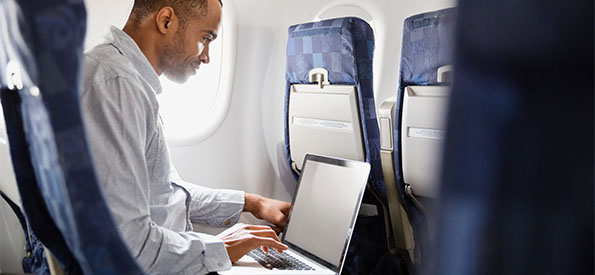 Image of man using wi-fi on airline