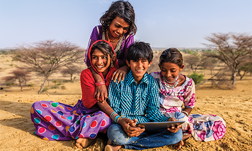 Children playing on a Tablet with Internet in India